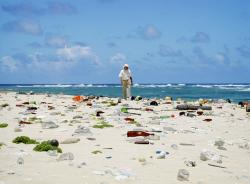 Jean-Michel Cousteau walks beach littered with Marine Debris