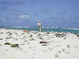 Jean-Michel Cousteau walks the littered beaches of the Northwestern Hawaiian Islands