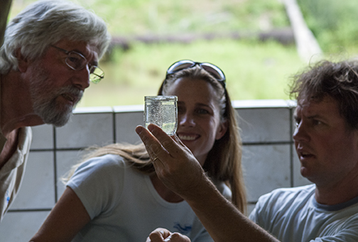 While on expedition in the Amazon, Jean-Michel Cousteau and Holly Lohuis learn all about sustainable, closed contained fish farms from Dr. Alexandre Honczaryk, researcher at National Institute for Amazonia Research.  Here Alex is showing Jean-Michel and Holly the eggs of a  prized Amazonian fish, tambaqui, a herbivore that has been easily overfished in much of the Amazon basin. Photo by Carrie Vonderhaar