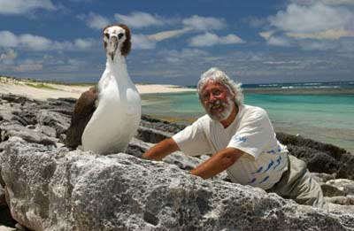 Jean-Michel Cousteau with a young Laysan Albatross